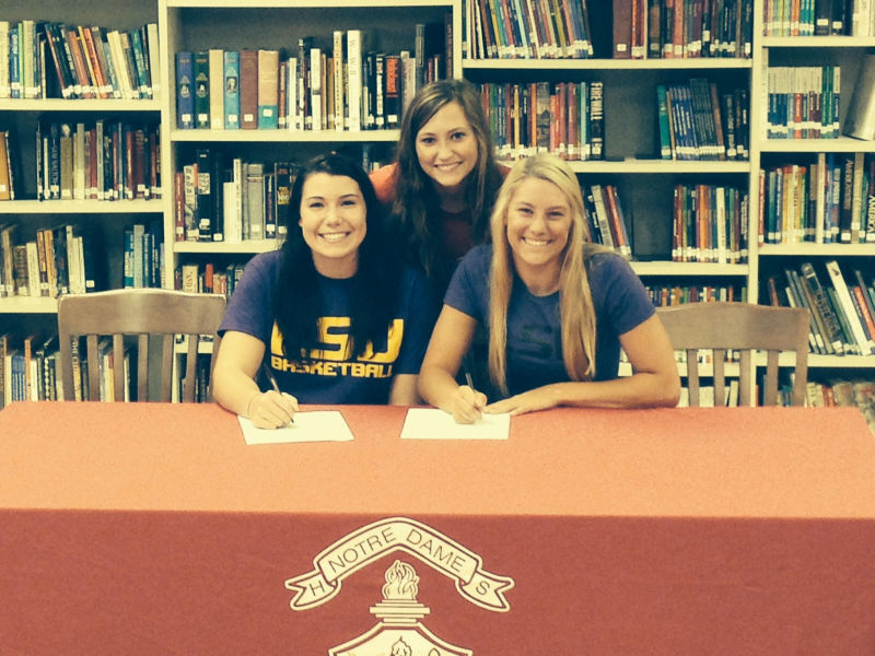 1st LADY PILOTS SIGN TWO NOTRE DAME HIGH SCHOOL STANDOUTS Photo
